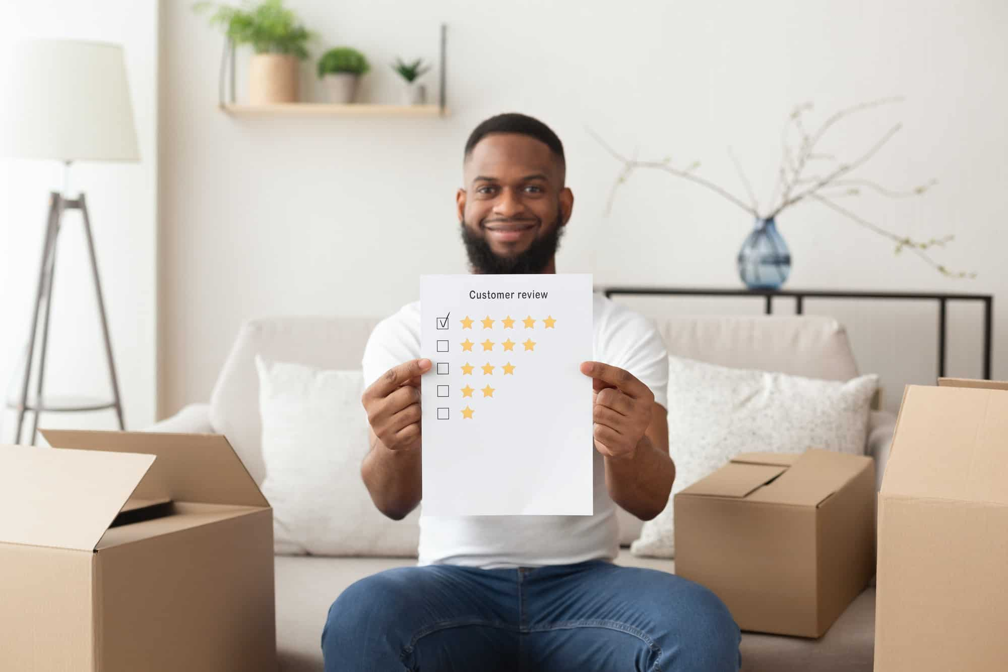 African american man puts five stars at customer review